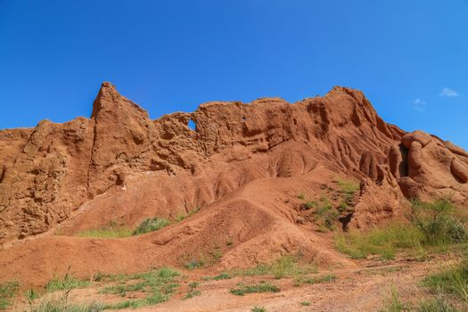 Red sandstone rock formations Seven bulls and Broken heart, Jeti Oguz canyon in Kyrgyzstan, Issyk-Kul region, Central Asia
