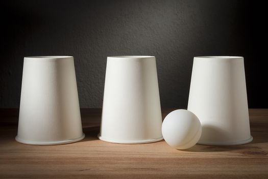 Disposable paper cups and ping pong ball