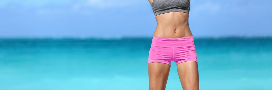 Toned abs fitness woman body weight loss banner. Fit healthy body on ocean background crop banner. Sexy body beach woman showing off slim curves and musculuar torso. Weight loss success.
