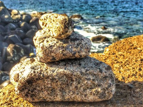 Zen stones on a rock near the atlantic ocean