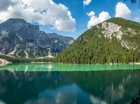 Hiking along the beautiful Braies lake in the Dolomites, South Tyrol