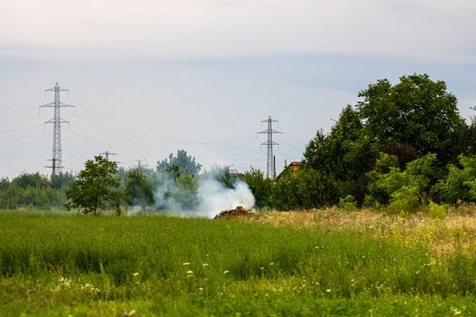 Fire and smoke in the agricultural field.