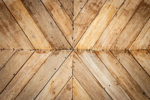 seamless brown color lumber in arrows or chevron pattern to the