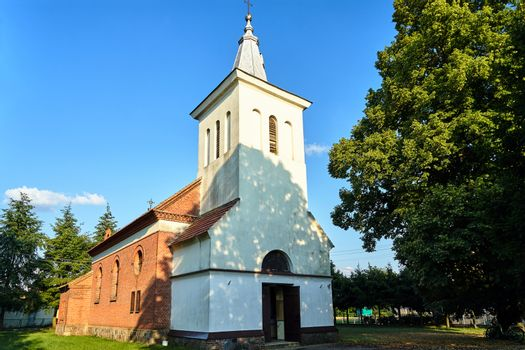 historic parish church with a bell tower in the village of Zemsko