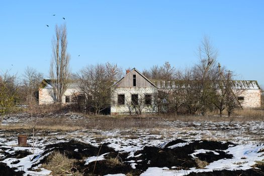 Abandoned house. The old structure of kindergarten. Winter on the abandoned buildings.