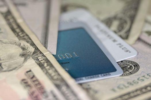 Dollar bills and credit cards