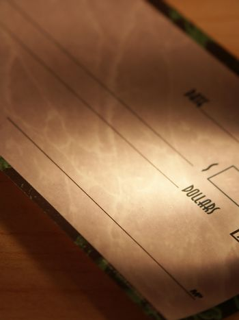 Dollar check book on a table