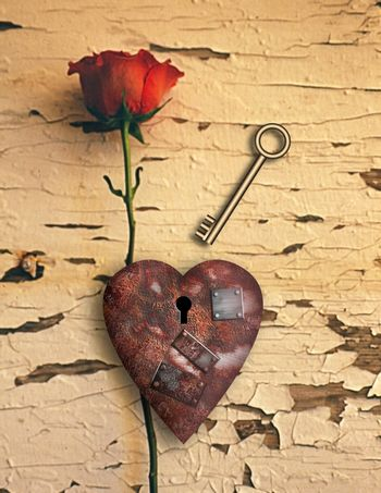 Surrealism. Red rose and rusted heart with metal patches and keyhole. Golden key.