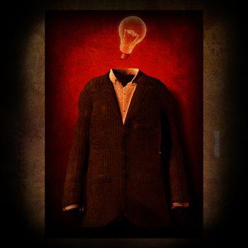Symbolic composition. Men suit and light bulb