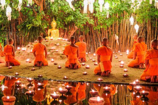 CHIANG MAI THAILAND - NOVEMBER 14 : Buddhist monks praying for the Loy Krathong festival at Wat Phan Tao on November 14, 2016 in Chiang Mai, Thailand.