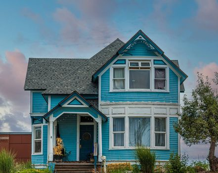 A Blue Victorian House on Hill
