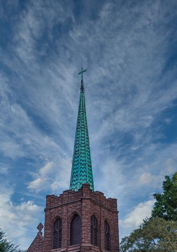 Old Bell Tower and Green Steeple of an Old Stone Church