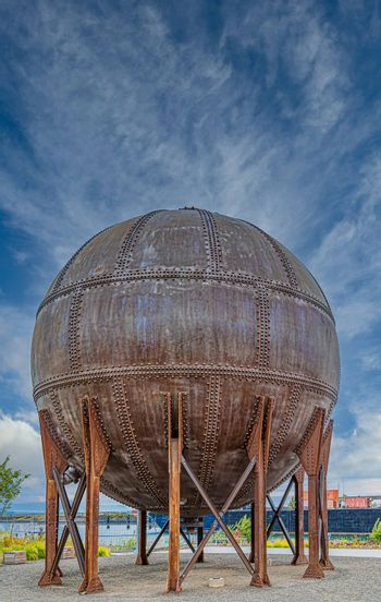 Round Rusty Tank with Rivets on Coast