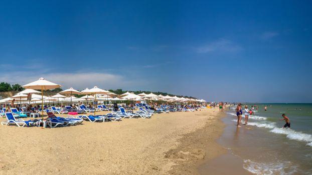 Odessa, Ukraine 05.07.2020. Black Sea Bugaz hotel and beach in Gribovka resort village near Odessa, Ukraine, on a sunny summer day