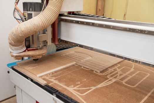 Wooden furniture production. Industrial machine for automatic wood drilling the mounting holes