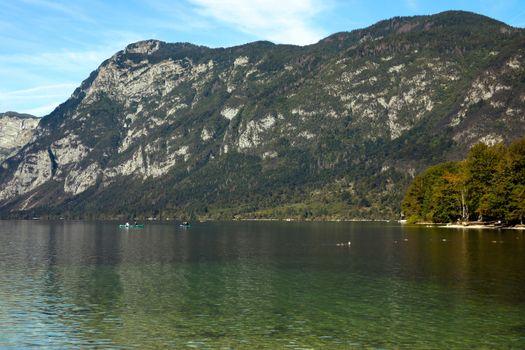 Bohinj lake shore with mountain views in Slovenia
