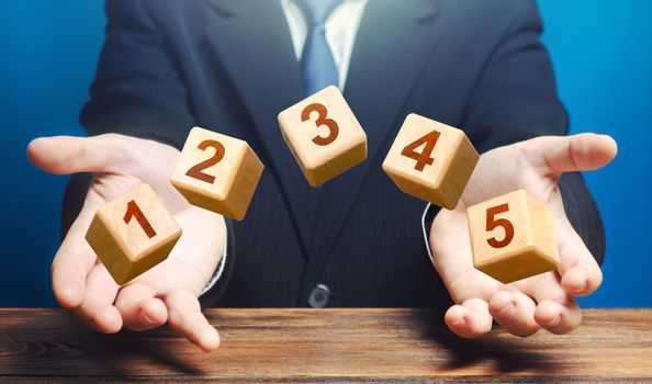 Man throws 5 numbered blocks with the numbers one two three four five from his hands. Five easy steps. Organization and systematization, step by instructions. Business planning, action plan.