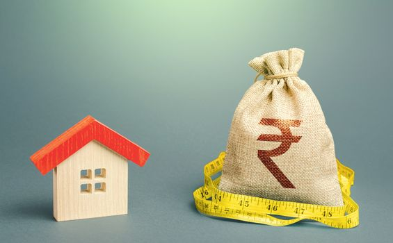 House and a indian rupee money bag. Mortgage loan. Property real estate valuation. Calculation of expenses for purchase, construction and repair. Buying and selling, fair price. Building maintenance.