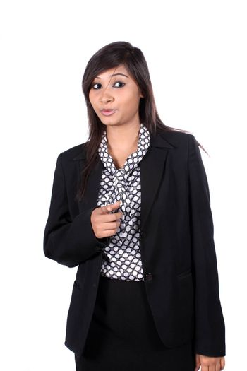 A young beautiful Indian businesswoman warning, on white studio background.