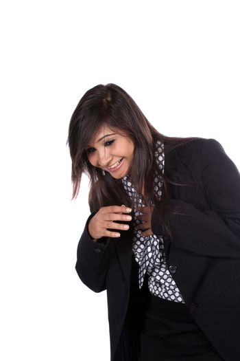 A beautiful young Indian businesswoman laughing, on white studio background.