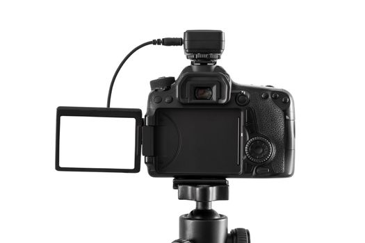 DSLR camera on a tripod isolated on white background with clipping path