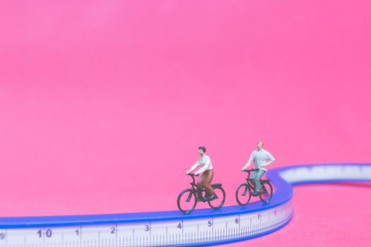 Miniature people travellers with bicycle on The bridge