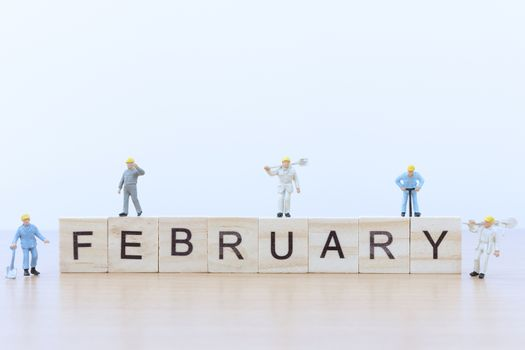 February words with Miniature people worker