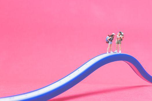 Miniature people : Couple of travellers on The bridge