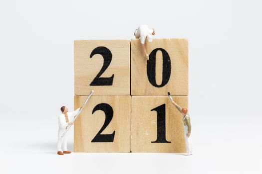 Miniature worker team painted number 2021 , Happy new year concept