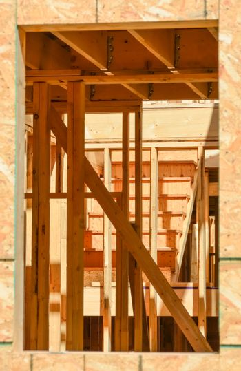 Future interior of new townhouse looked through a window.