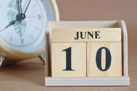 June 10, Cover design with clock in natural concept.
