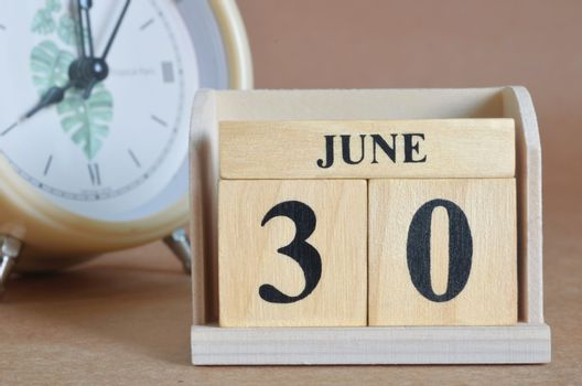 June 30, Cover design with clock in natural concept.