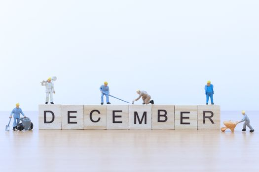 December words with Miniature people worker