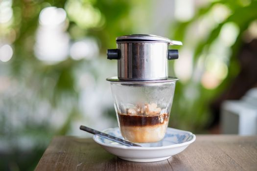 Affogato coffee with ice cream on a glass cup with natural background