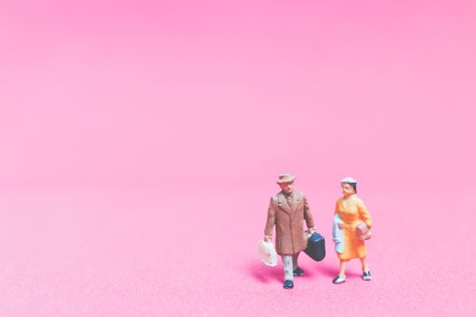 Couple of travellers on pink background