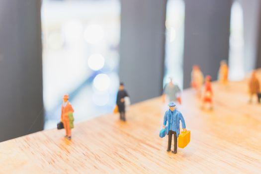 Miniature people : Travellers walking on The bridge