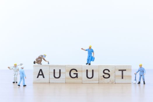 August words with Miniature people worker