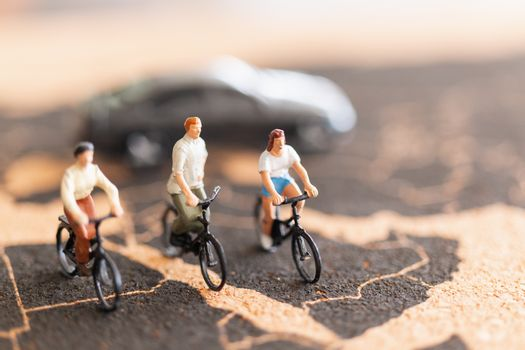 Miniature people travellers with bicycle