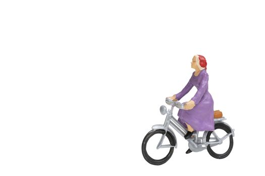 Miniature people travellers with bicycle isolate on white backgr