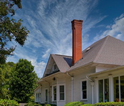 Tall Brick Chimney in Farmhouse in Rural area