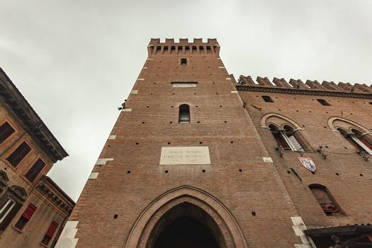 Detail of Tower of the town hall building in Ferrara in Italy
