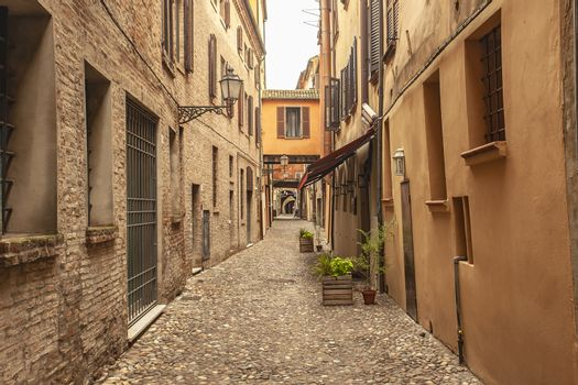 An historical empty alley in the historical city center of Ferrara in Italy