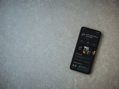 Lod, Israel - July 8, 2020: GoPro - Video Editor and Movie Maker app play store page on the display of a black mobile smartphone on ceramic stone background. Top view flat lay with copy space.