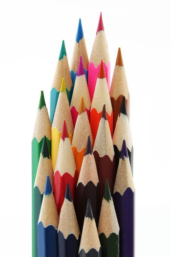 A group of multi colored pencils isolated on white background