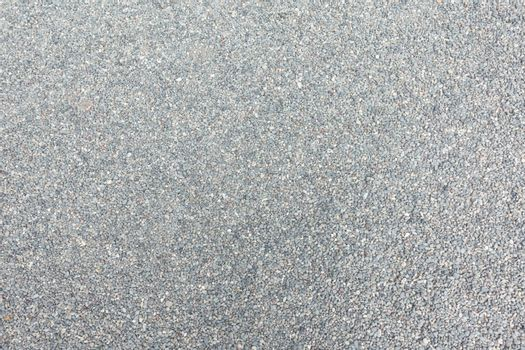 Abstract background of dry round stones in wide angle