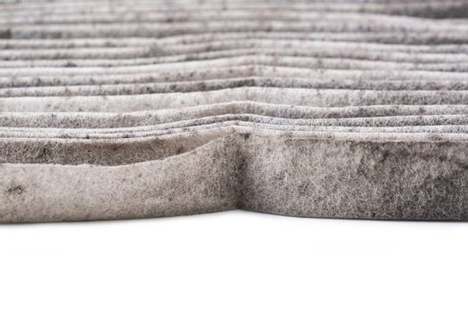 dirty car air conditioning filter isolated on white background