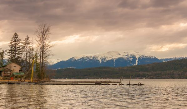 Spring sunset behind a snow covered Mount Hipp on Lakelse Lake, British Columbia, Canada