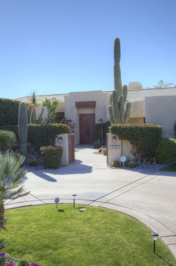 Entrance of luxury villa with tall cactus