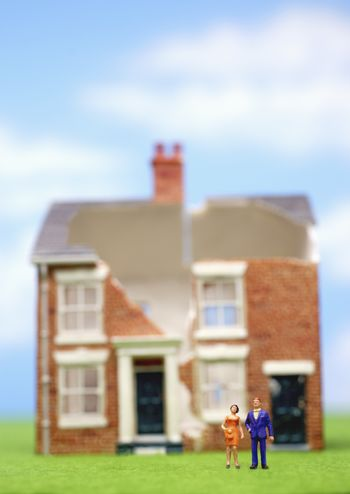 Couple in front of brick house