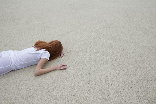 Woman Lying Face Down on Beach